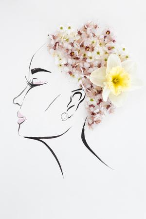 手は、白で隔離された自然花髪型で女性のプロファイルを描画されます。ファッション イラスト-