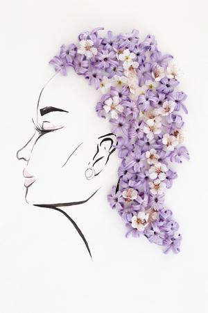 手は、白で隔離された自然花髪型と美しい女性のプロファイルを描画されます。ファッション イラスト- 写真素材