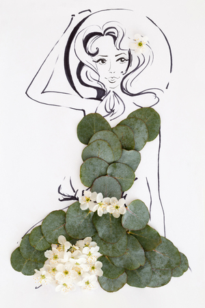 Hand drawn beautiful female silhouette wearing natural floral pattern dress isolated over white. Fashion illustration