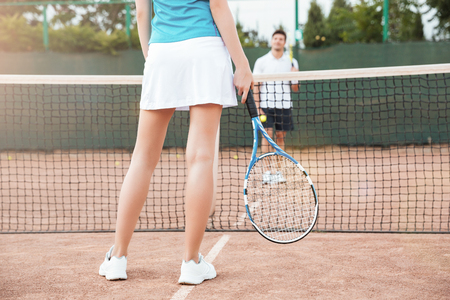 Tennis players playing a match on the court. cropped image