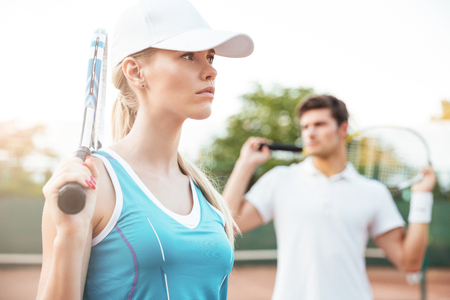 Fashion tennis couple. man on the background Stock Photo