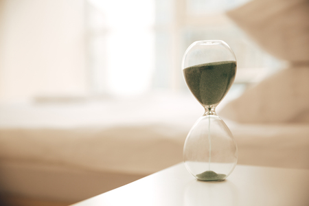 Image of hourglass on table indoors