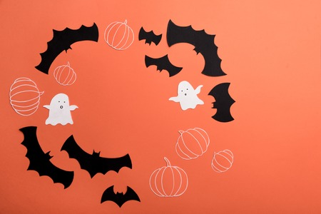 Traditional haloween symbols of black bats, pumpkins and ghosts on red background. Haloween picture and frame for logo Stock Photo