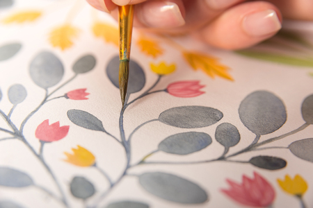 Close up of flowers design painted with btush and watercolors on paper