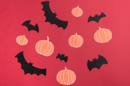 Different traditional haloween symbols of pumpkins and bats on red background Stock Photo