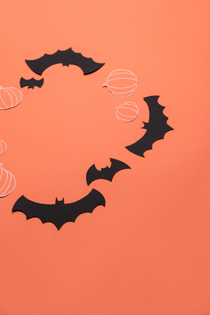 Traditional haloween symbols of black bats and pumpkins on red background. Haloween picture and frame for logo