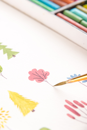 Close up of different colorful flowers nature design painted with brush and watercolors on paper