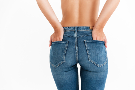 Image of sexy ass in jeans of woman over white background 写真素材