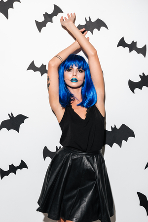 Image of amazing young woman in witch halloween costume on party over white background. Looking camera. 스톡 콘텐츠