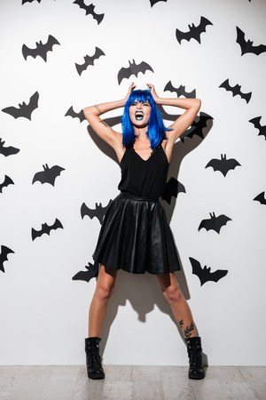 Photo Of Emotional Screaming Young Woman In Witch Halloween Costume.. Stock  Photo 55fac673b73f