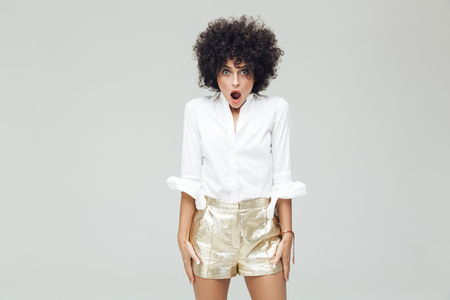 Image of young shocked retro woman dressed in shirt standing and posing isolated. Looking camera. Stock Photo
