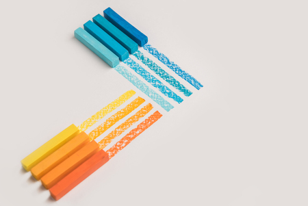 Close up of color pastel crayon chalks over its own trace line, isolated over white background Фото со стока