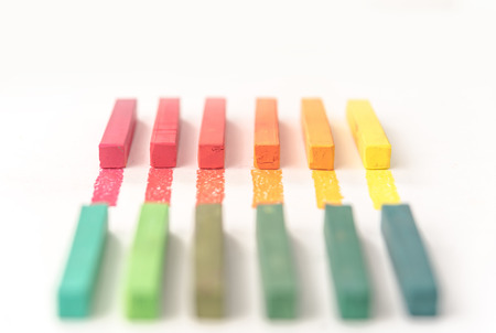 Close up of colorful pastel chalks and their pigments on white background Stock Photo
