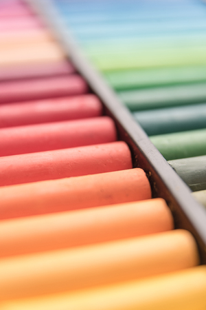 Close-up image of colorful chalk pastels in box