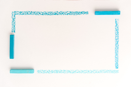 Close up photo of drawing lines by blue pastel chalks, on white paper background Фото со стока