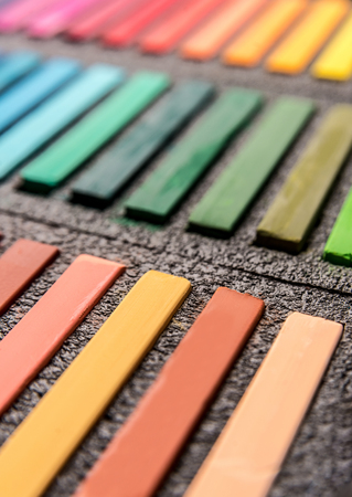 Close-up photo of new colorful chalk pastels in box, selective focus