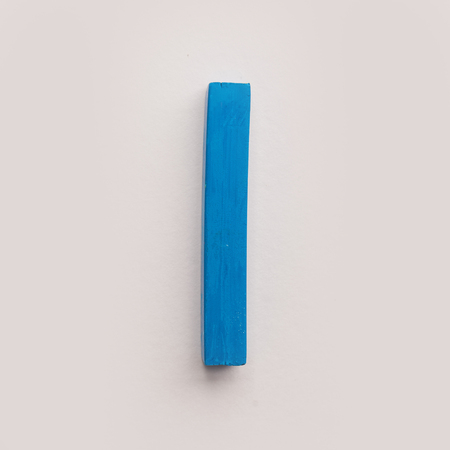 Blue pastel crayon chalk isolated over white background Фото со стока