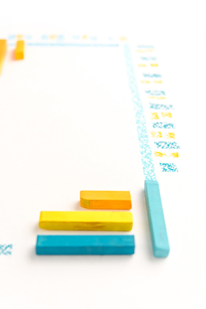 Cropped photo of color chalk drawing as striped line on white paper background Фото со стока