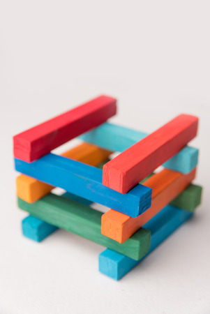Close up of colorful chalks tower, over white background Stock Photo