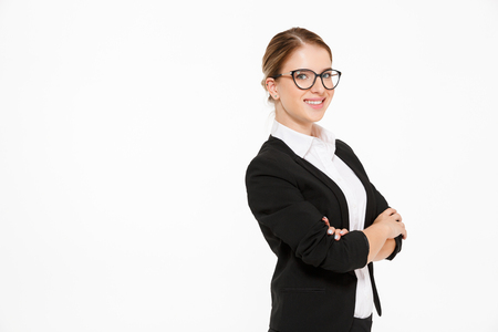 Side view of smiling blonde business woman in eyeglasses looking at the camera over white background