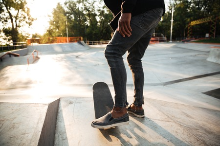 Close up of skateboarders feet skating on concrete Imagens