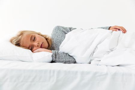 Close-up portrait of sleeping blonde girl