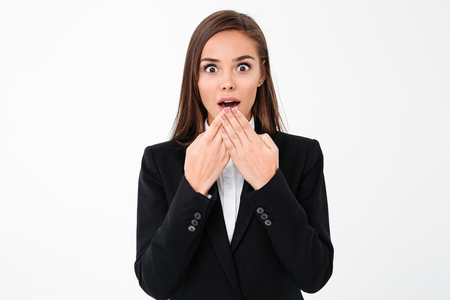 Photo of shocked surprised business woman standing isolated over white background. Looking camera. Stock Photo