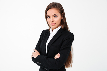 Image of amazing cheerful business woman standing with arms crossed isolated over white background. Looking camera. Stock Photo