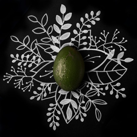 Avocado over outline floral hand drawn background