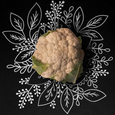 Cauliflower over outline floral hand drawn background