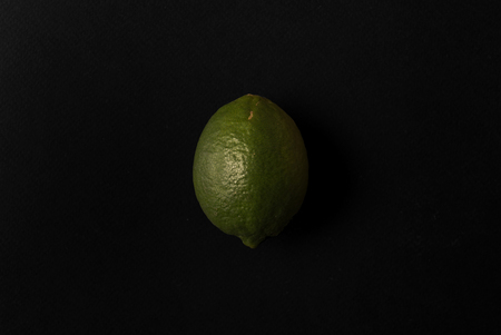 Fresh lime isolated over black background