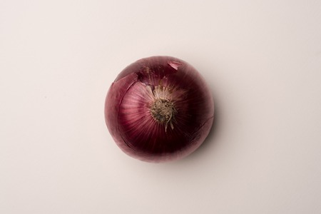 Fresh red onion over white background