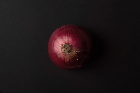 Fresh red onion over black background Stock Photo