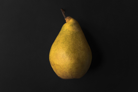 Close up of a fresh pear isolated over black background Stock Photo