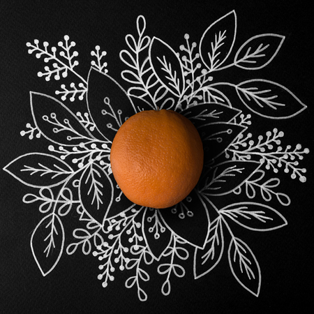 Orange fruit over outline floral hand drawn background