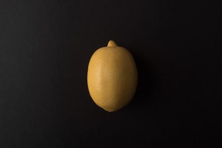 Fresh lemon isolated over black background Stock Photo