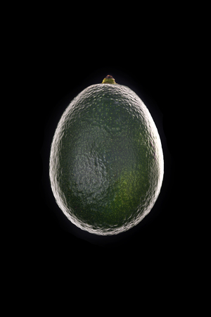 Ripe avocado silhouette isolated over black background