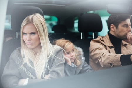 Picture of angry displeased young family sitting in car after quarrel. Looking aside. 版權商用圖片 - 91952926