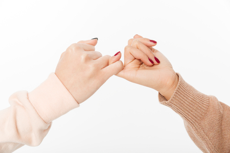 Two hands hook each others little finger concept of promise Stock Photo