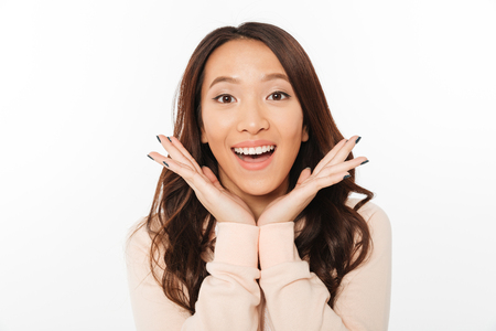 Image of asian shocked positive lady standing isolated over white background looking camera.