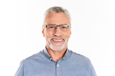 Cheerful happy mature man in glasses looking camera and smiling isolated over white