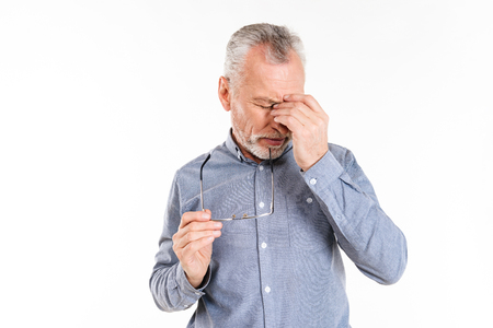 Old man in formal wear have a headache isolated over white 免版税图像