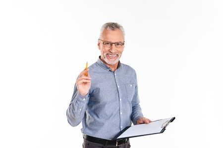 Cheerful mature man in glasses holding folder and smiling to camera isolated over white