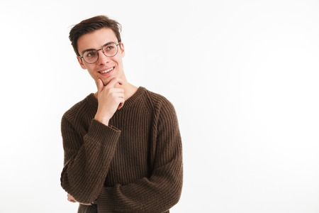 Close up portrait of a smiling young man in sweater looking away at copy space isolated over white background Stock Photo