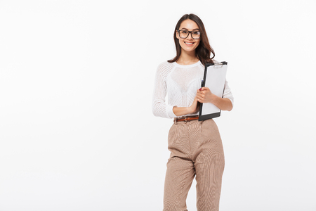 Portrait of a confident asian businesswoman holding clipboard isolated over white background