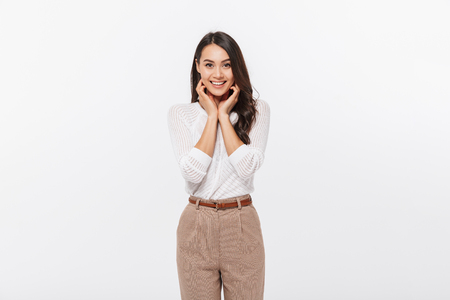 Portrait of a lovely asian businesswoman looking at camera isolated over white background 版權商用圖片