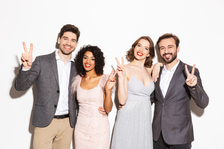 Group of happy well dressed multiracial people having fun together isolated over white background