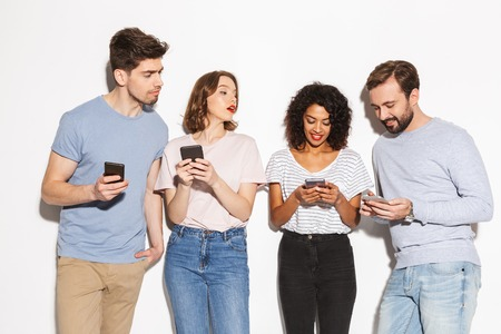 Group of modern multiracial people using mobile phones isolated over white background