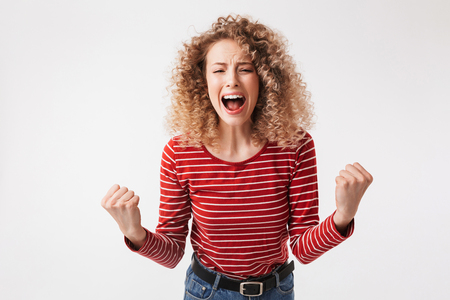 Portrait of angry young girl with curly hair screaming isolated over white background 스톡 콘텐츠