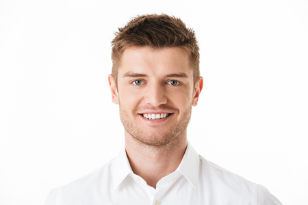 Close up portrait of a smiling young man looking at camera isolated over white background 스톡 콘텐츠
